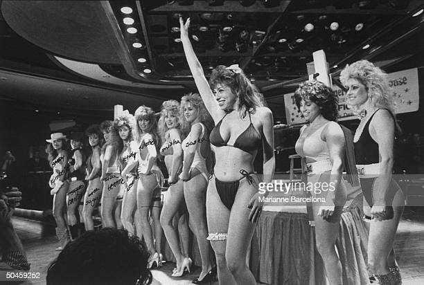 Lineup of 11 smiling young women boxers of Bill Dean Foxy Boxing Revue at his nightclub Great American Clubhouse, incl. Sasha Allen, Kristie Lear,...