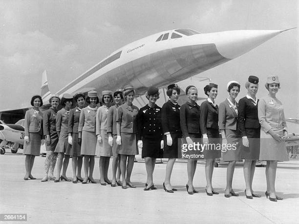 Line-up of some of the air stewardesses who attend to passengers on board 'Concorde', each one from a different airline. They are standing in front...