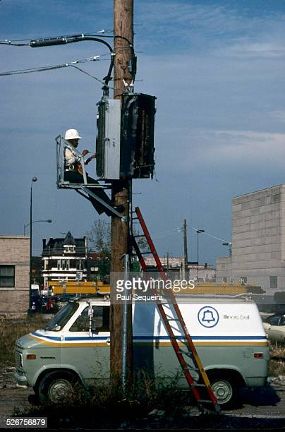 A linewoman for Illinois Bell the telephone company works on a utility pole Chicago Illinois 1980