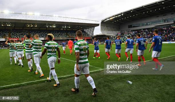 Linfield and Celtic make their way onto the pitch during the Champions League second round first leg qualifying game between Linfield and Celtic at...