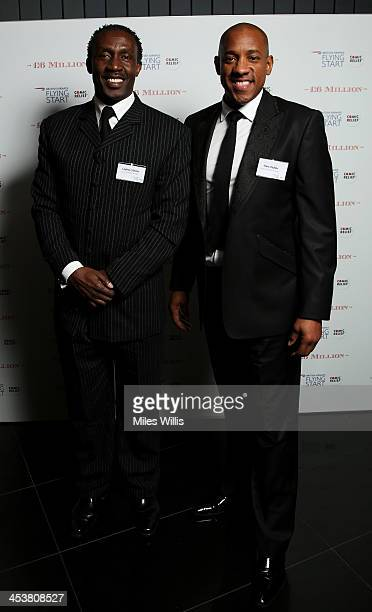 Linford Christie and Dion Dublin attend the British Airways 'Milestone in the Sky' event at 30 St Mary Axe on December 5 2013 in London England...