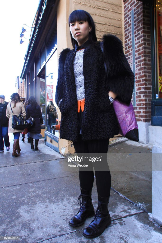 Ling Ang, Filmmaker from Australia, wearing a Miu Miu coat, Marni shirt, Livia Arena sweater, Museum shorts, H&M tights, Junya Watanabe boots, Deadly Ponies bag, and Vintage jewelry wearing on January 17, 2013 on the streets of Park City, Utah.