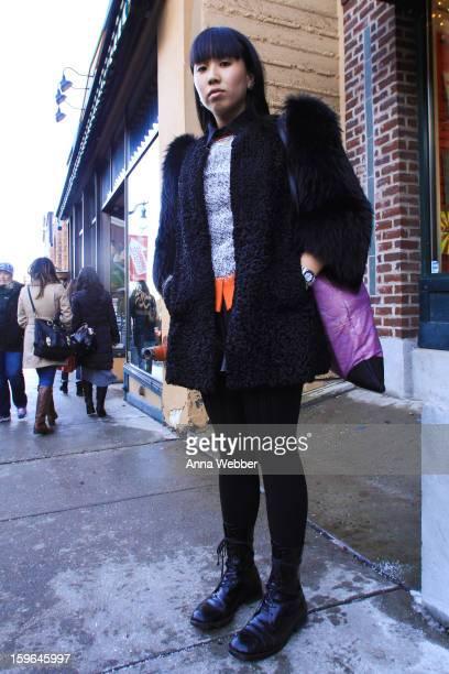 Ling Ang, Filmmaker from Australia, wearing a Miu Miu coat, Marni shirt, Livia Arena sweater, Museum shorts, H&M tights, Junya Watanabe boots, Deadly...