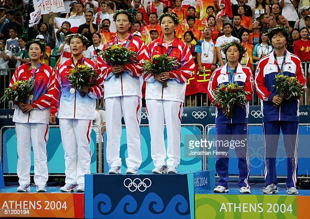 Ling Gao and Sui Huang of China Jiewen Zhang and Wei Yang of China and Kyung Min Ra and Kyung Won Lee of Korea receive their medals for the women's...