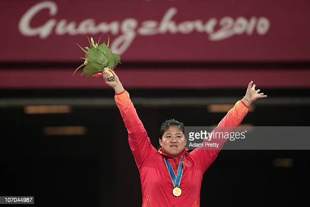 Ling Li of China celebrates on the medal stand after winning the gold medal in the women's shot put final at Aoti Main Stadium during day nine of the...