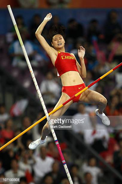 Ling Li of China competes in the Women's Pole Vault Final at Aoti Main Stadium during day twelve of the 16th Asian Games Guangzhou 2010 on November...