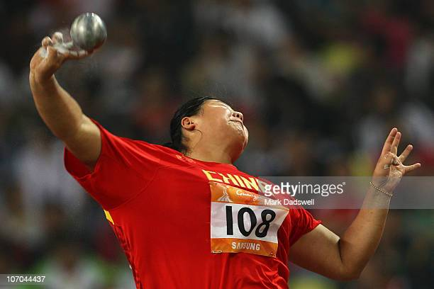 Ling Li of China competes in the women's shot put final at Aoti Main Stadium during day nine of the 16th Asian Games Guangzhou 2010 on November 21...