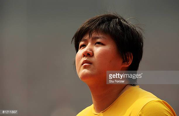 Ling Li of China looks on before the start of Womens Shot Putt qualification during day two of the Good Luck Beijing 2008 China Athletics Open at...