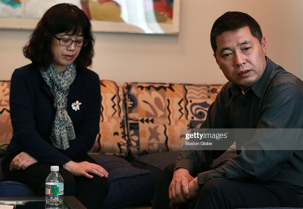 Ling Meng, left, and Jun Lu, right, the parents of Boston Marathon bombing victim Lingzi Lu are pictured as they speak to a reporter about their late daughter at a Boston hotel. (Globe Staff Photo/Jim Davis) section:metro topic 15marathonpic2