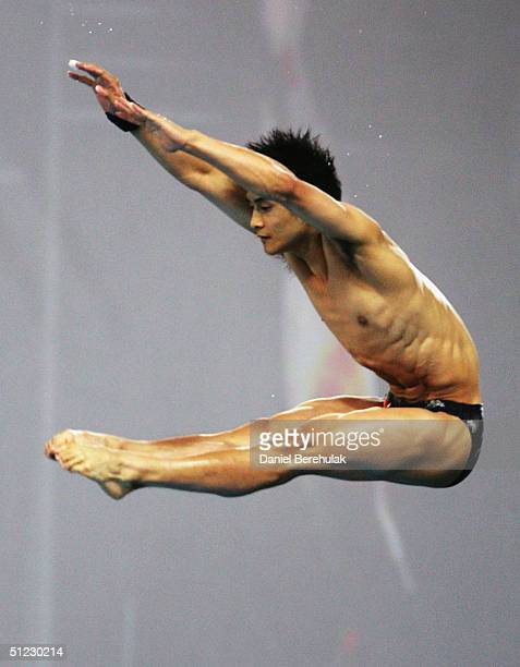 Ling Tian of China competes in the men's diving 10 metre platform semifinal on August 28 2004 during the Athens 2004 Summer Olympic Games at the...