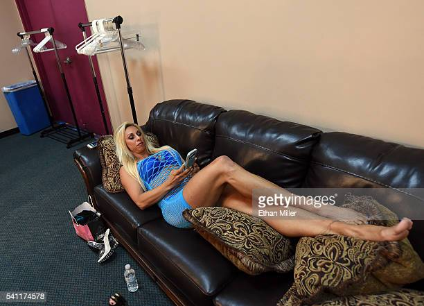 Lingerie Fighting Championships champion Feather The Hammer Hadden relaxes on a couch backstage before her match against Allie Babydoll Parks during...