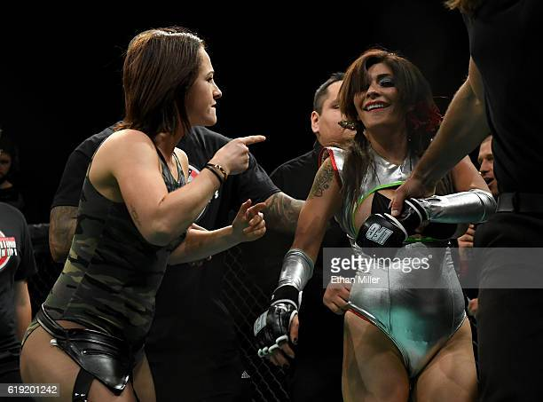 Lingerie Fighting Championships President Maxine Frost helps remove fighter Shelly Aphrodite DaSilva from the cage after she was disqualified for...