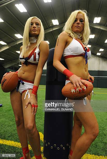 Lingerie Football League players Ether Grey and Melissa Teixeira pose for a photo at the start of an open tryout session for aspiring players to try...