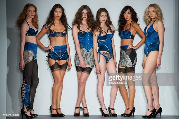 Lingerie models parade down the catwalk at a contour design fashion show in Freemasons' Hall London