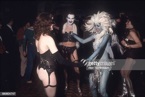 Lingerieclad men and women dance with a woman in feathers and body paint at the opening party at the Copacabana nightclub New York New York October...