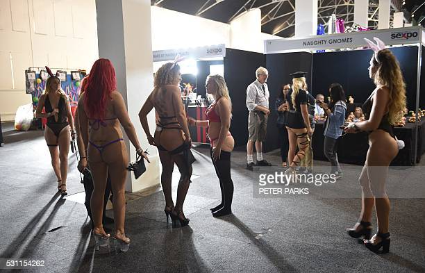 """Lingerie-clad women take part in the Sexpo Sydney 2016 exhibition in Sydney on May 13, 2016. The annual """"Sexpo"""" adult exhibition is an annual health,..."""