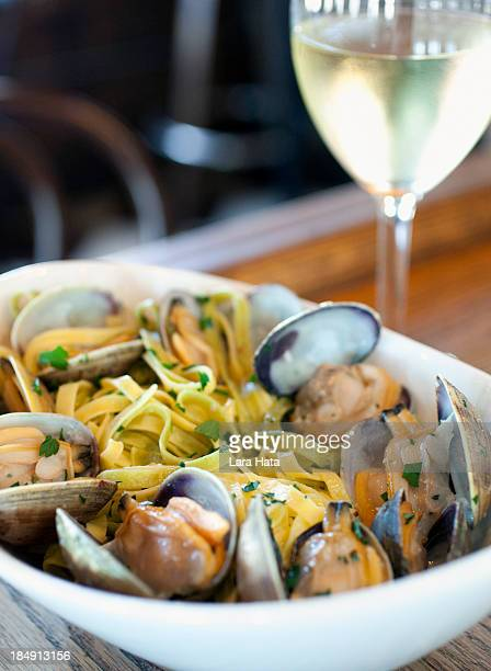 linguine with clams - chardonnay grape stock photos and pictures