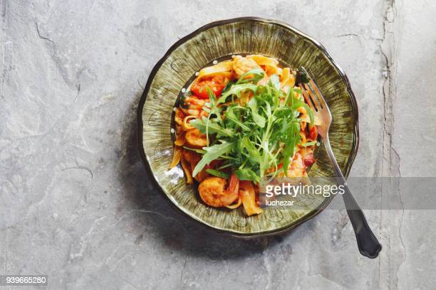 Linguine with tomato sauce and prawns