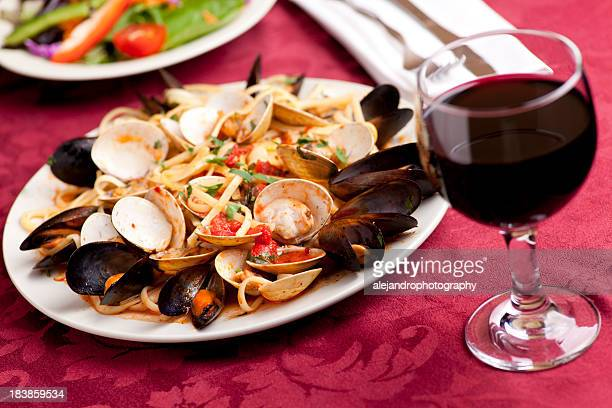 linguini with mussels and clams - cabernet sauvignon grape stock photos and pictures