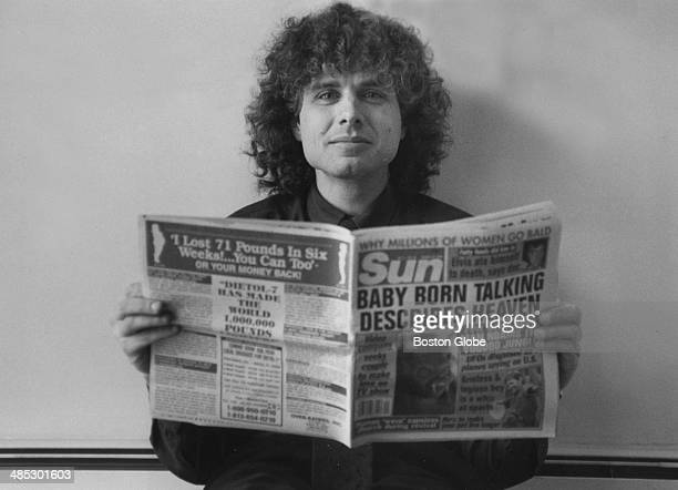 MIT linguistics professor Steven Pinker author of 'The Language Instinct How the Mind Creates Language' poses for a portrait reading a tabloid the...