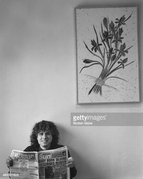 MIT linguistics professor Steven Pinker author of 'The Language Instinct How the Mind Creates Language' poses for a portrait reading a tabloid the...