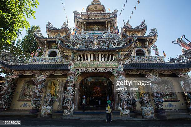 Linh Phuoc Pagoda is called the bottle temple because there is a dragon having covered with fragments of broken bottles of beer Visitors enjoy the...