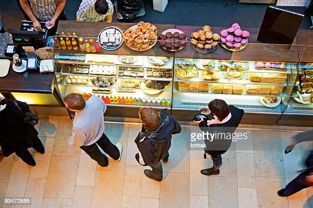 lining up at cafe' with tasty pastry for a snack. - lining up stock pictures, royalty-free photos & images