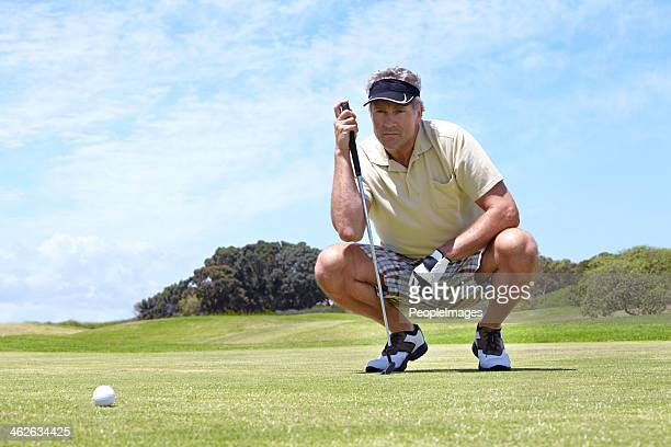 lining up his shot - putting stock pictures, royalty-free photos & images