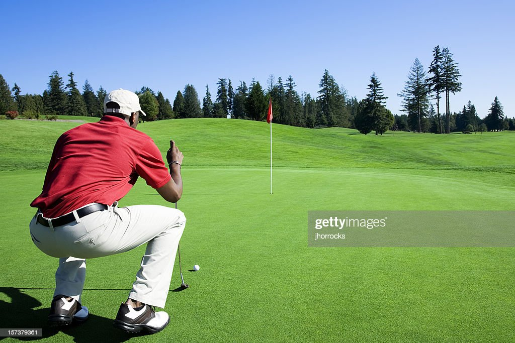 Lining Up The Putt : Stock Photo