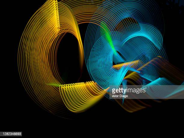linked circular gold and blue lines - electronic music stock pictures, royalty-free photos & images