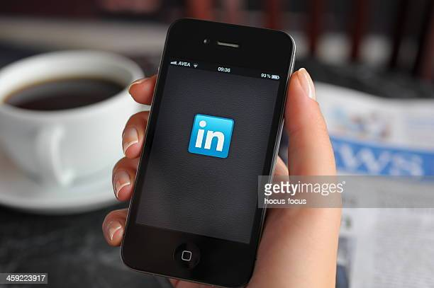 linkedin app on apple iphone 4 - brand name stock pictures, royalty-free photos & images