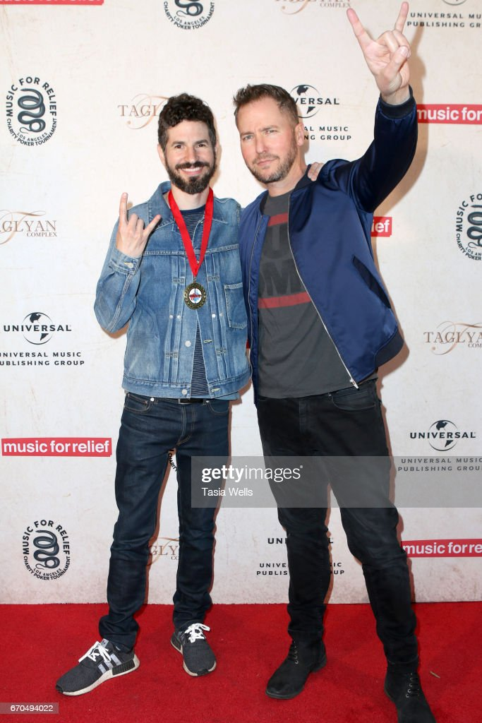 Linkin Park guitarist Brad Delson (L) and radio personality Stryker attend Linkin Park's Music for Relief - Charity Poker Tournament at Taglyan Cultural Complex on April 19, 2017 in Hollywood, California.