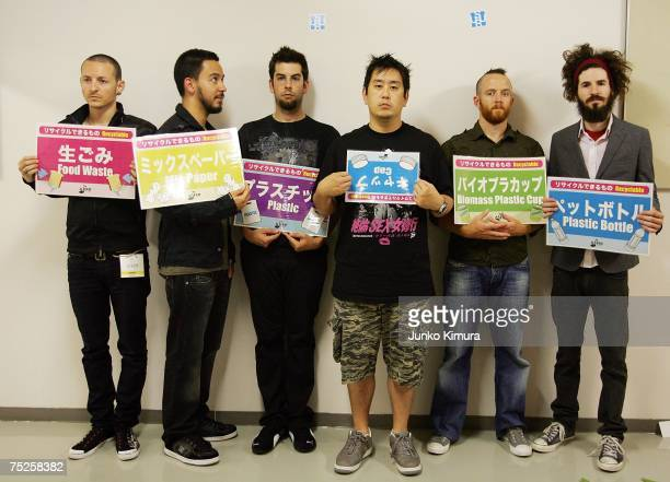 Linkin Park hold signs at the backstage at the Tokyo leg of the Live Earth series of concerts, at Makuhari Messe, Chiba on July 7, 2007 in Tokyo,...