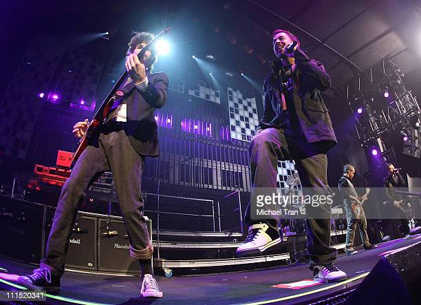 Linkin Park musicians Brad Delson and Mike Shinoda perform at KROQ's Almost Acoustic Xmas Day 1 held at Gibson Amphitheatre on December 8 2007 in...