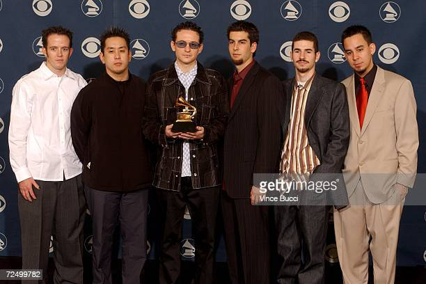 Linkin Park pose backstage during the 44th Annual Grammy Awards at Staples Center February 27 2002 in Los Angeles CA Linkin Park won Best Hard Rock...