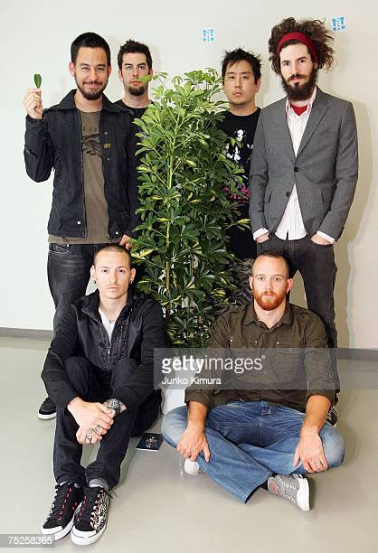 Linkin Park pose with a tree at the backstage at the Tokyo leg of the Live Earth series of concerts at Makuhari Messe Chiba on July 7 2007 in Tokyo...