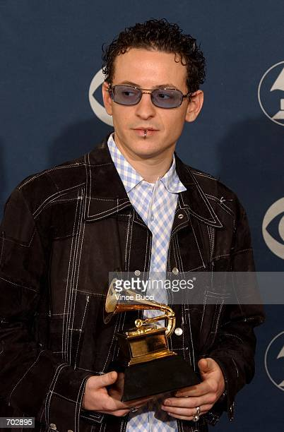 Linkin Park singer Chester Bennington poses backstage during the 44th Annual Grammy Awards at Staples Center February 27 2002 in Los Angeles CA...