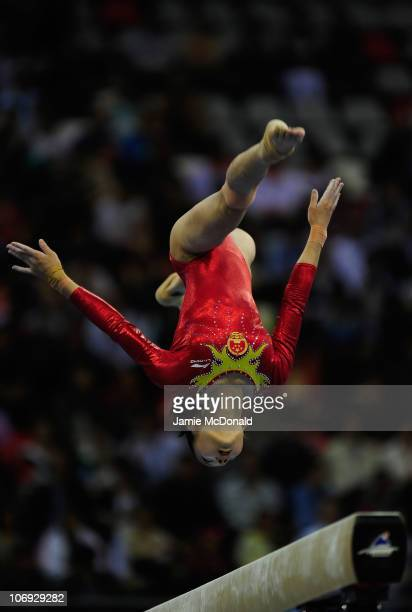 Linlin Deng of China competes on the Beam of the Apparatus Final at the artistic gymnastics during day five of the 16th Asian Games Guangzhou 2010 at...
