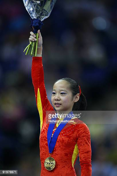 Linlin Deng of China poses with her gold medal after she won the beam event during the Apparatus Finals on the sixth day of the Artistic Gymnastics...