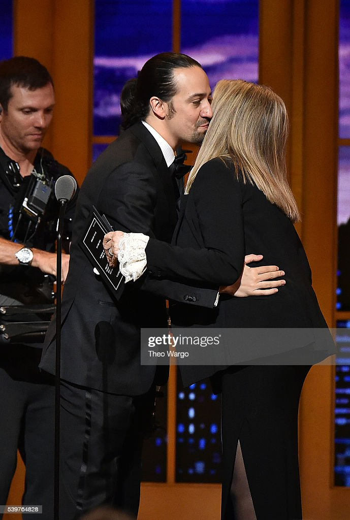 Lin-Manuel Miranda accepts the Tony award for Best Musical for 'Hamilton' from Barbra Streisand onstage during the 70th Annual Tony Awards at The Beacon Theatre on June 12, 2016 in New York City.