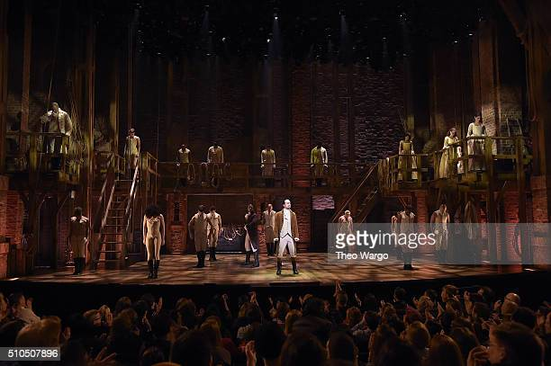 LinManuel Miranda and cast of Hamilton performs on stage during Hamilton GRAMMY performance for The 58th GRAMMY Awards at Richard Rodgers Theater on...