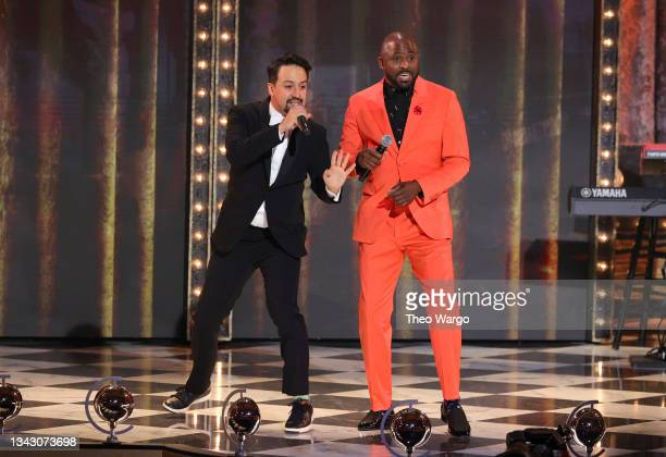 Lin-Manuel Miranda and Wayne Brady perform onstage during the 74th Annual Tony Awards at Winter Garden Theatre on September 26, 2021 in New York City.