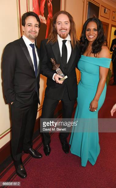 "Lin-Manuel Miranda, Tim Minchin, accepting the Best New Musical award for ""Groundhog Day"", and Audra McDonald pose in the winners room at The Olivier..."
