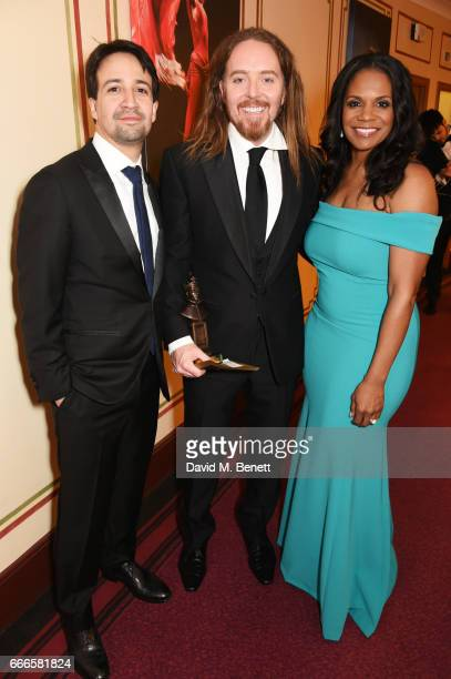 LinManuel Miranda Tim Minchin accepting the Best New Musical award for 'Groundhog Day' and Audra McDonald pose in the winners room at The Olivier...