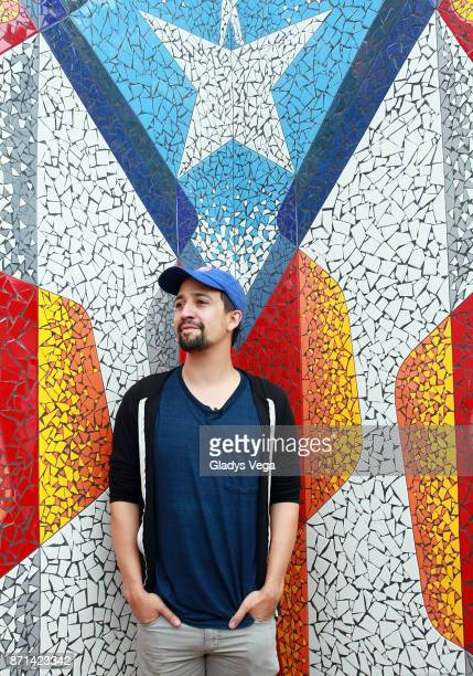 LinManuel Miranda unveils the Puerto Rican flag art at La Placita de Guisin on November 7 2017 in Vega Alta Puerto Rico