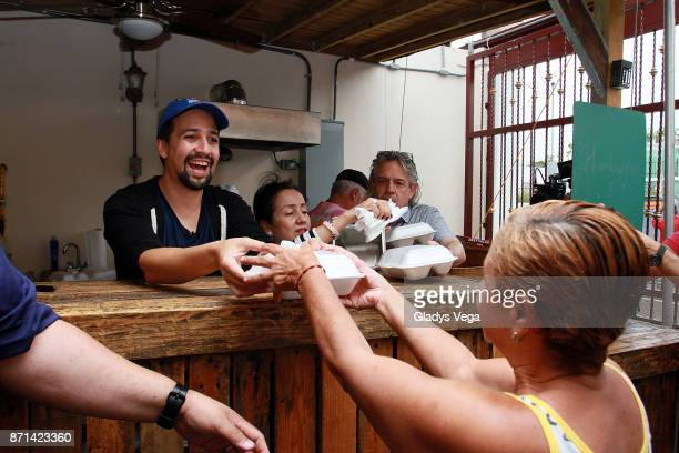LinManuel Miranda with his parents Luz Towns Miranda and Luis Miranda deliver food to victims of Hurricane Maria at La Placita de Guisin on November...