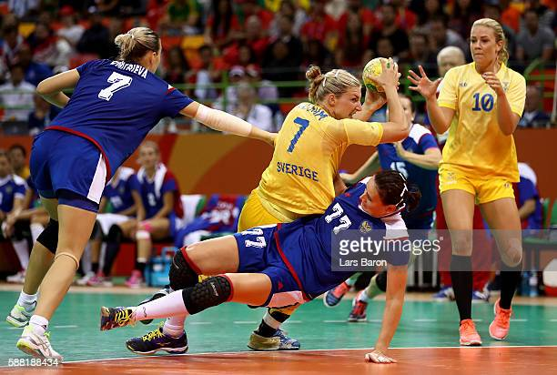 Linn Blohm of Sweden is challenged by Mayya Petrova of Russia during the Womens Preliminary Group B match between Russia and Sweden at Future Arena...