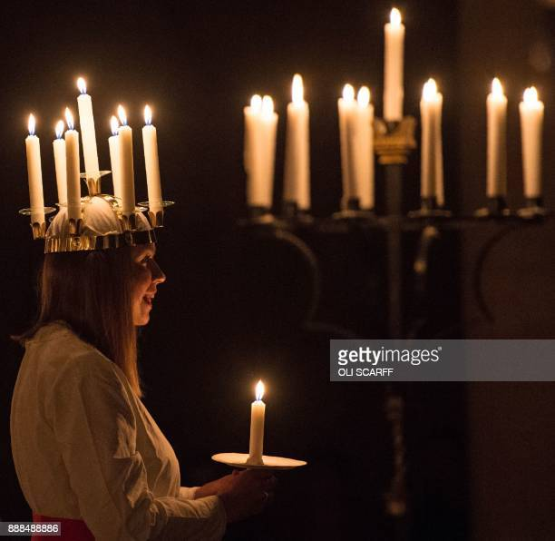 Linnea Hennersten from Lidkoping in southwest Sweden plays the role of Lucia during the Swedish 'Sankta Lucia Festival of Light' service at York...