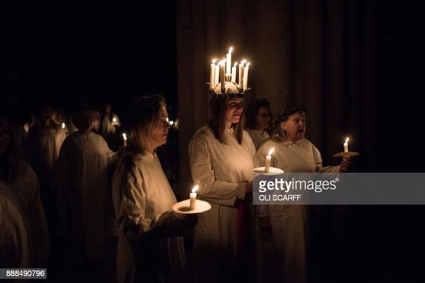 Linnea Hennersten from Lidkoping in southwest Sweden plays the role of Lucia as she leads the procession during the Swedish 'Sankta Lucia Festival of...