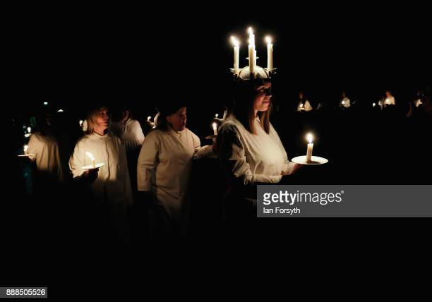Linnea Hennersten from Lidkoping Sweden plays the role of Lucia as she leads the procession during the Swedish Sankta Lucia festival of Light service...